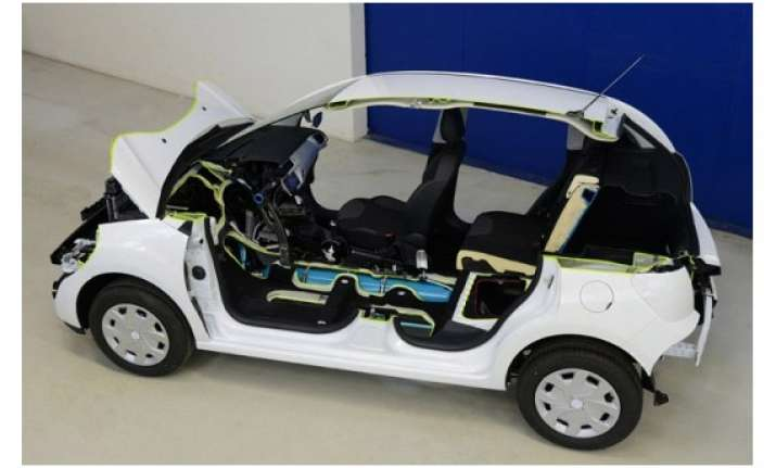 peugeot to launch air powered hybrid car in 2015