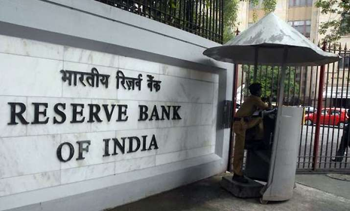 rbi keeps rate unchanged inflation to guide future action