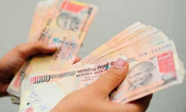 rupee at 2 week high up 21 paise