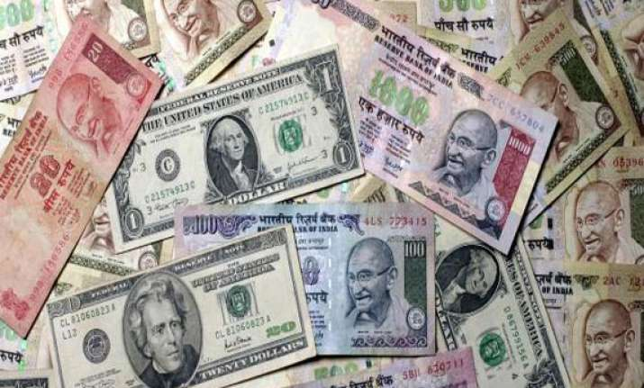 rupee continues to slide vs dollar drops 15 paise