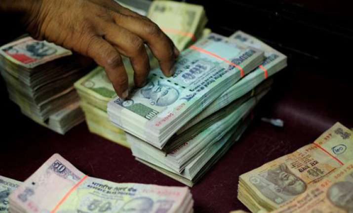 rupee ends flat at 59.90 against dollar