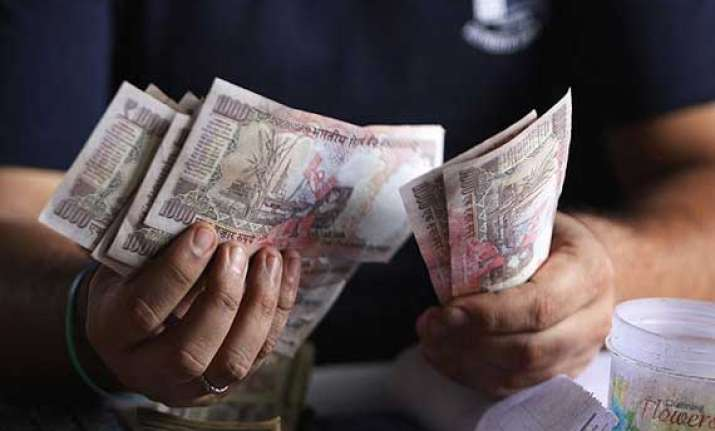 rupee ends 2 paise lower against dollar