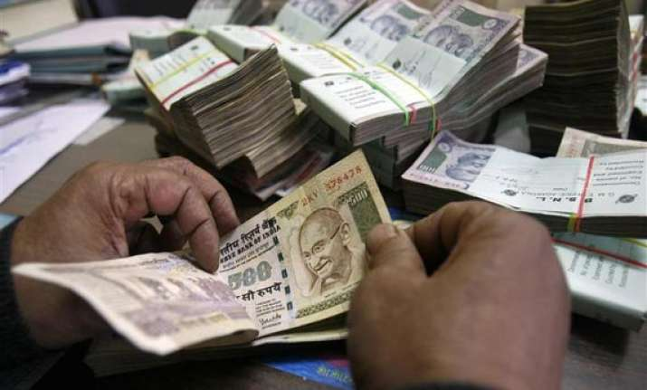 rupee erases early gains ends down 6 paise at 61.52 vs