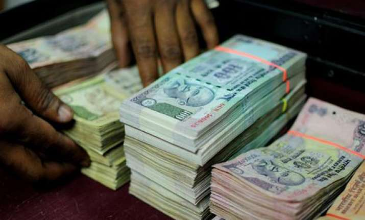 rupee falls 35 paise to 61.79 against dollar as stocks