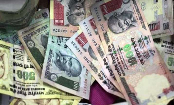 rupee sinks to 10 month low at rs 56.17 a dollar