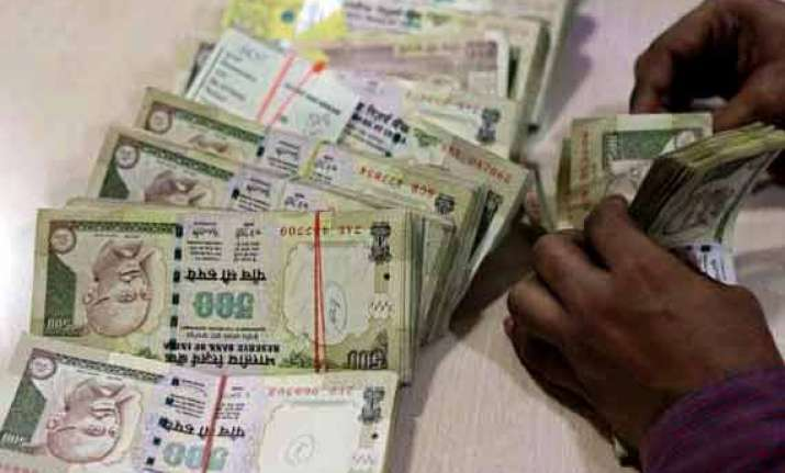 rupee slips from two week highs ends at 60.12 vs us dollar