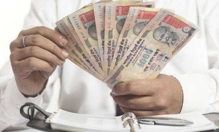 rupee tumbles to life time low of 67.35