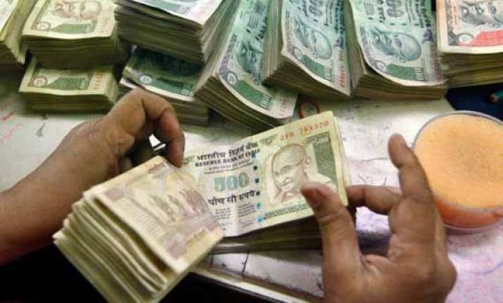 rupee up by 14 paise against dollar in early trade