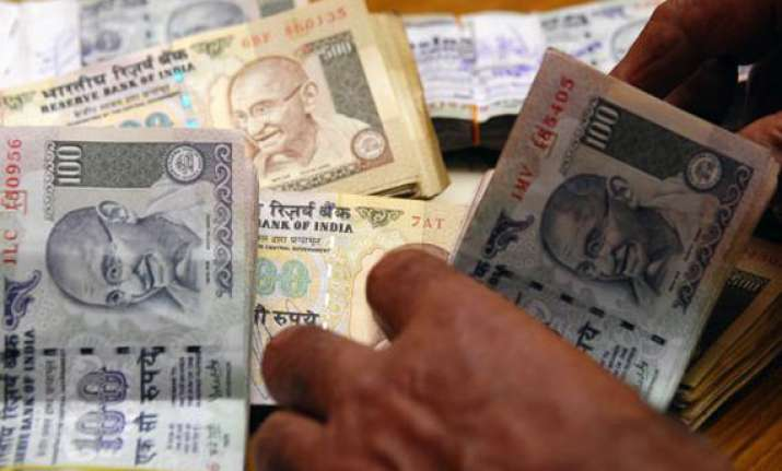 rupee up 73 paise to seven week high of 61.73 against dollar
