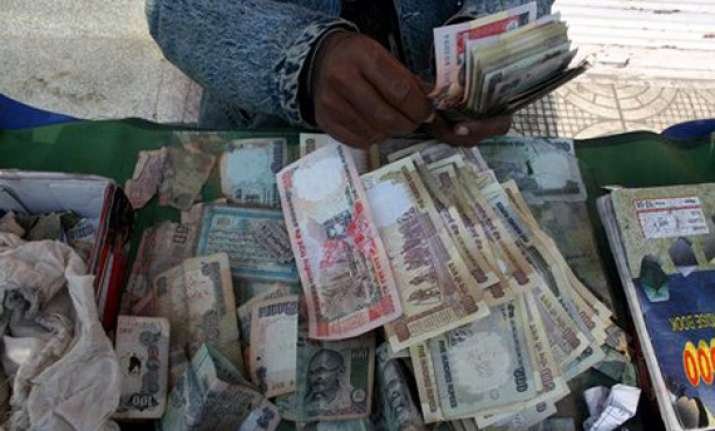 rupee at 3 mth high up 12 paise vs dollar on strong stocks