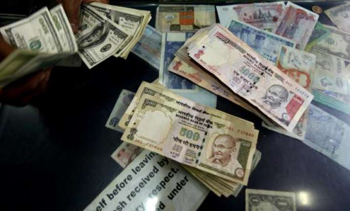 rupee hits all time low of 52.84 against dollar fiis may