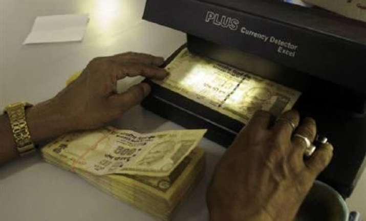 rupee down 17 paise at 49.36/37 against dollar