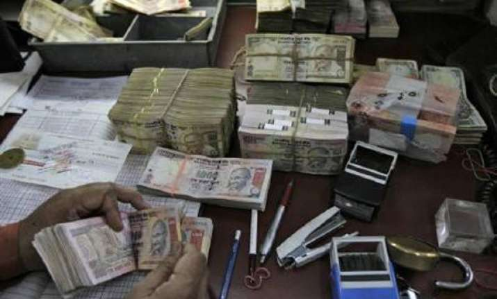 rupee tumbles by 62 paise against dollar
