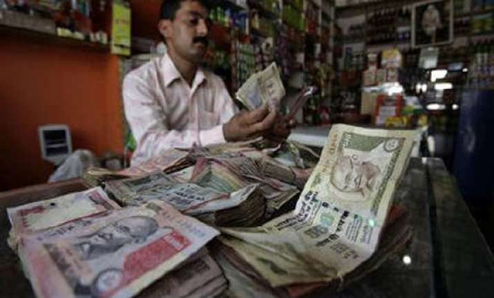 rupee hits two week high at 48.94/95 against dollar