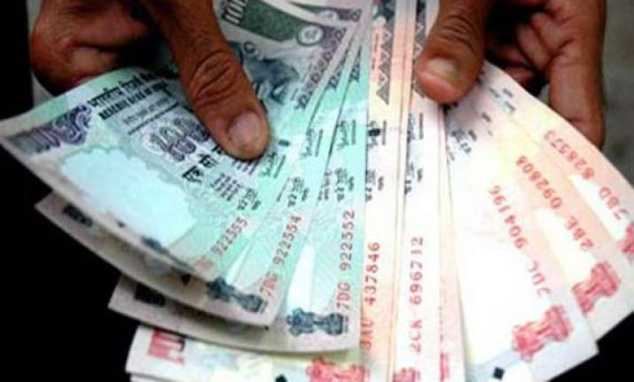 rupee up 26 paise at 51.20/21 against dollar