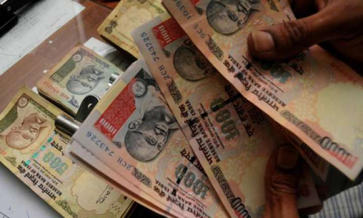 rupee erases initial gains closes 3 paise down against
