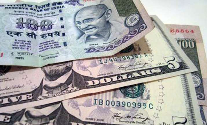 rupee gains 14 paise to 52.54/55 against the dollar
