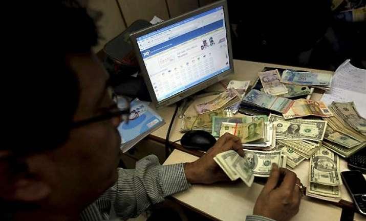 rupee ends flat at 52.55/56 vs dollar