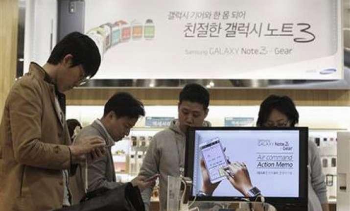 samsung s profit falls as smartphones get cheaper
