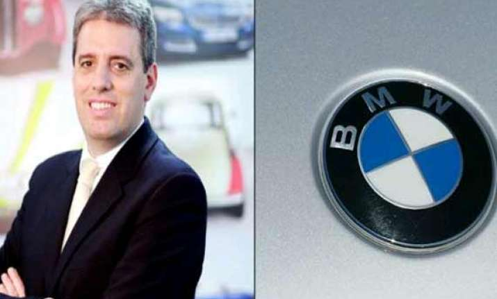 senior bmw executive arrested on charges of cheating