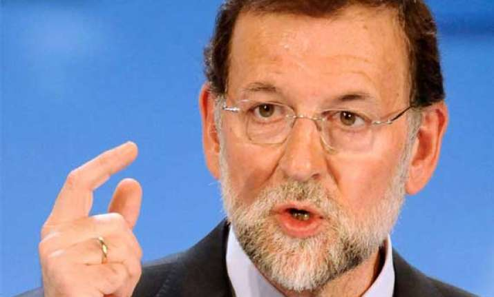 spain is overcoming serious crisis pm