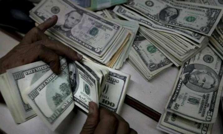 us dollar edges up against rupee
