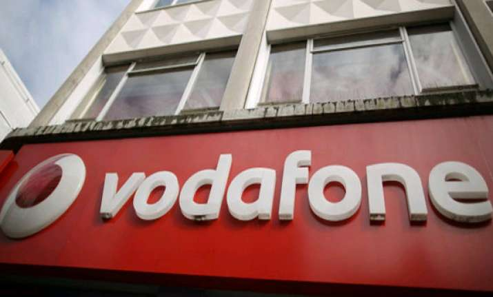 vodafone group may sell stake in bharti to comply with rules