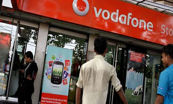 vodafone threatens international arbitration