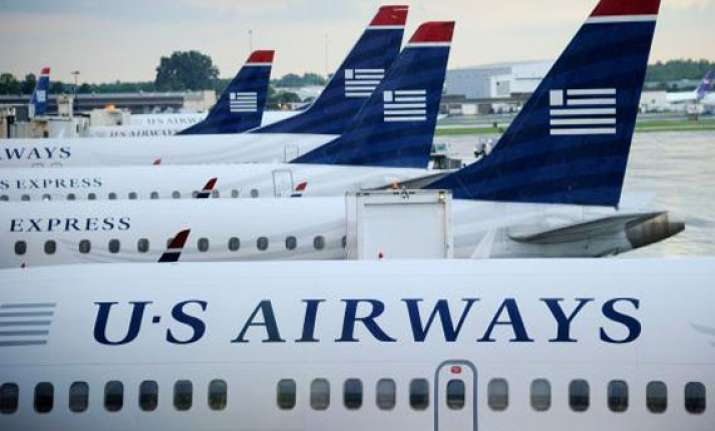 world s biggest airline emerges as us airways american