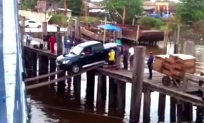car boarding on a ship using a plank video
