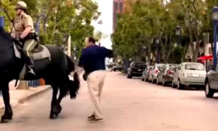 man pats horse. horse not too happy. see what happens next
