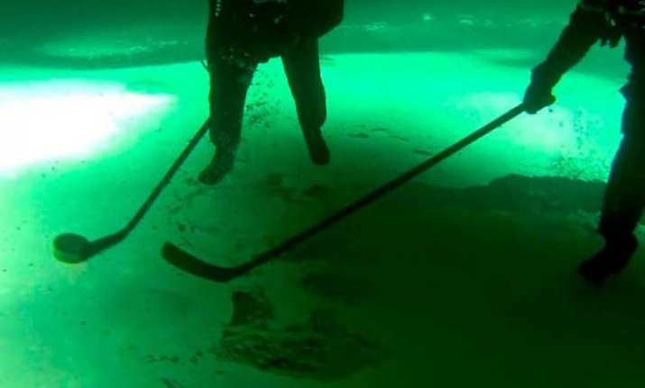 watch these siberian divers playing the first ever ice