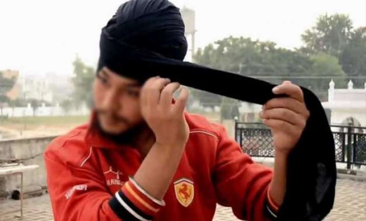 know what forced this sikh guy to remove his turban in