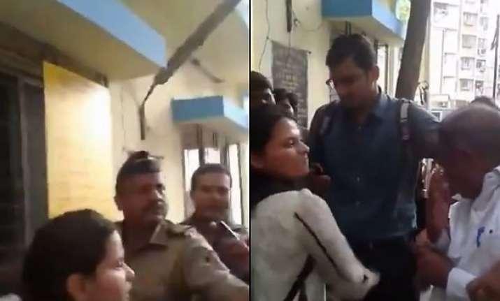 mumbai policeman remains mute spectator as girl kicks old