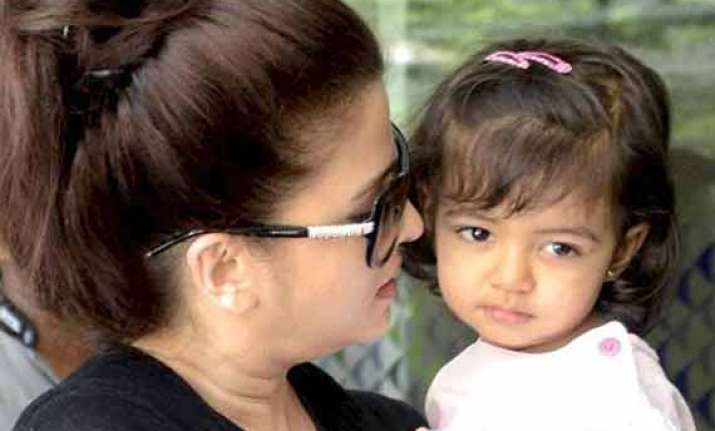 aaradhya introduced to writing on saraswati puja