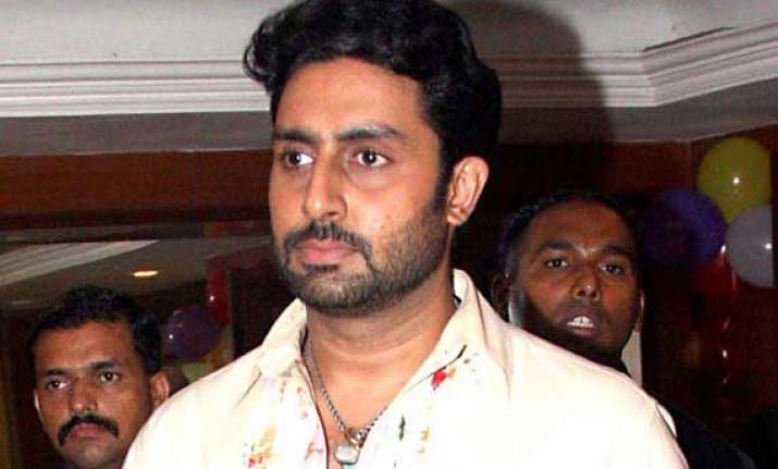 abhishek bachchan sweats out in gym
