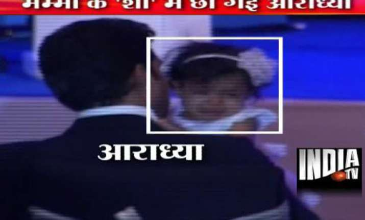 abhishek left holding the baby as aaradhya bawls after ash