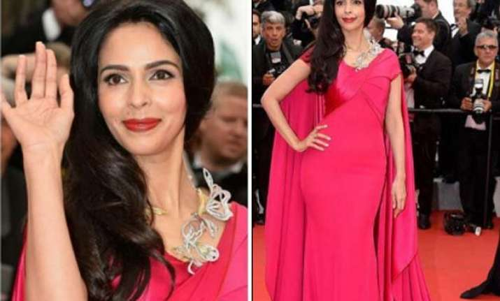cannes 2015 bold mallika sherawat covers up herself on red