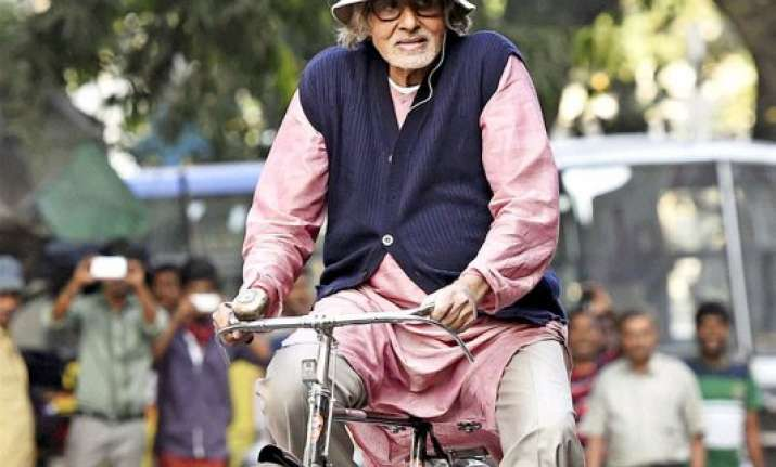 big b takes a ride on a bicycle during piku shoot