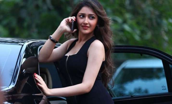 debutant actress sayesha s first look in ajay devgn s