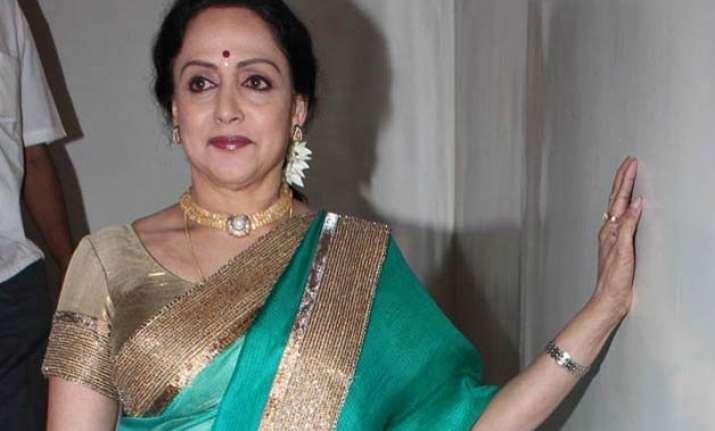 hema malini discharged from hospital reaches mumbai