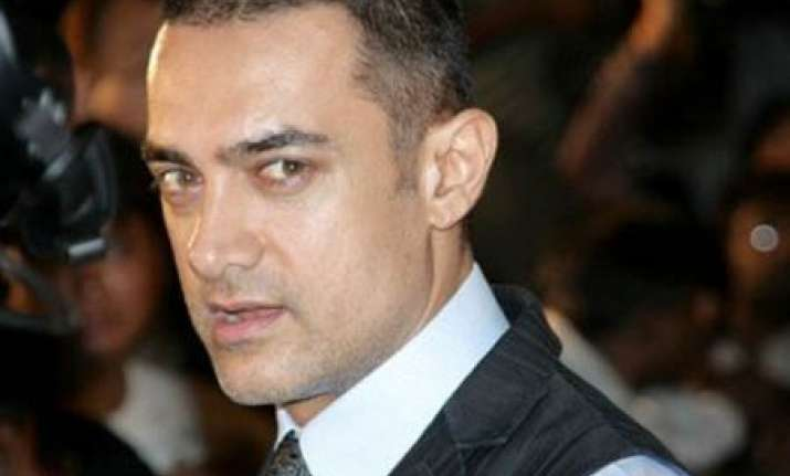 aamir gets his head shaved for his next film