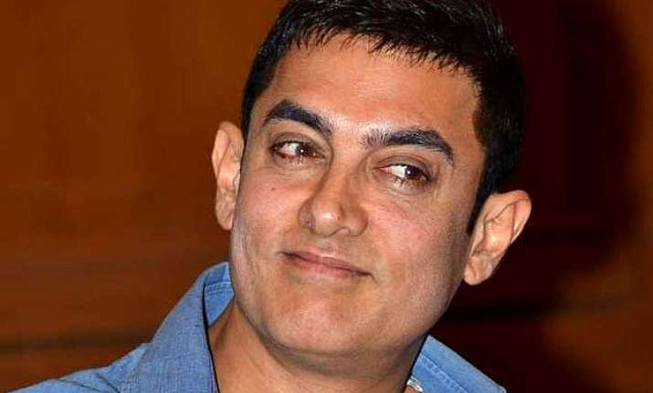 aib controversy aamir khan attacks russell peters hints at