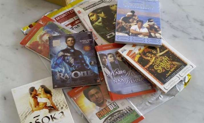 from bollywood with love srk gifts his films to paulo coelho