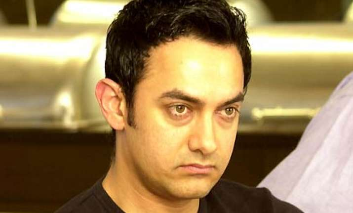aamir down with fever on return from australia