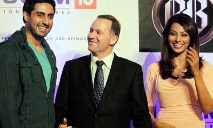 nz pm visits bollywood sets meets abhishek bipasha