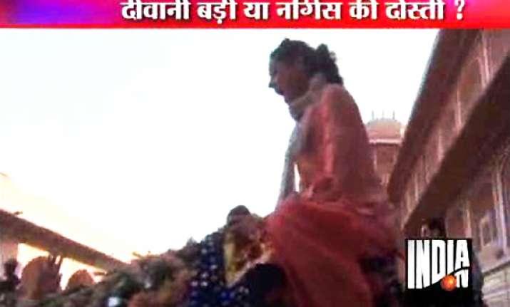 nargis fakhri screams as she rides a camel in jaipur