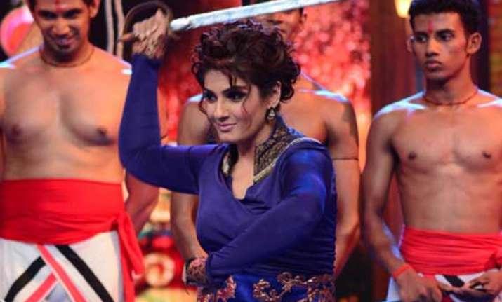 raveena tandon tries her hand at sword stunts