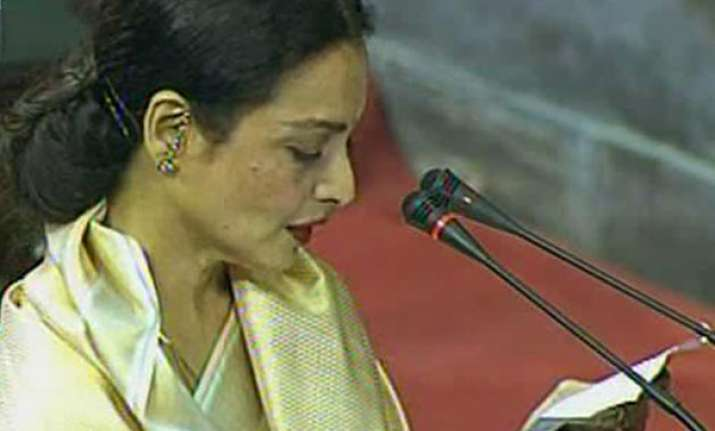 rekha takes oath in rs