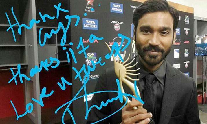 iifa 2014 dhanush grabs his first award posts picture